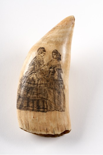 Scrimshaw depicting two well dressed ladies reading a book