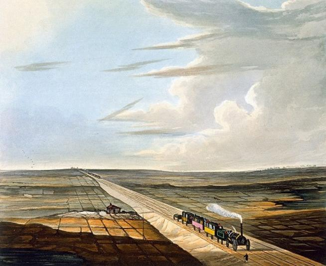 This is the full image of the section above. A railway line runs diagonally across the image and a steam locomotive pulling three coaches heads to the bottom right. Another steam train can be seen in the far distance. A patchwork of flat fields lie either side of the track, with a small station building on the left with a red roof. A blue sky rises above the scene.