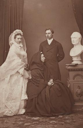 Queen Victoria, Prince Edward and Princess Alexandra photographed with a bust of Prince Albert soon after the Royal Wedding in 1863 by John Jabez Edwin Mayall (carbon print, courtesy of the National Portrait Gallery, London NPG x36269)