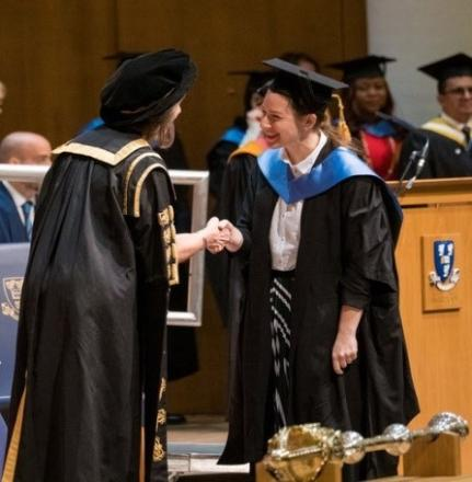 Student and the Vice Chancellor shaking hands during the graduation ceremony.