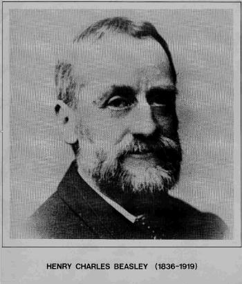 A black and white portrait photograph of a Victorian gentleman with a beard.
