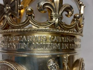 Inscription running around the crown of the University Mace