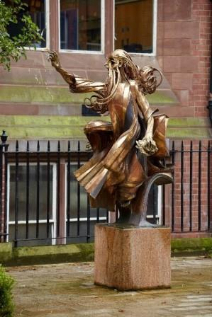 sculpture of a prophet from the old testament, robes flowing in a breeze