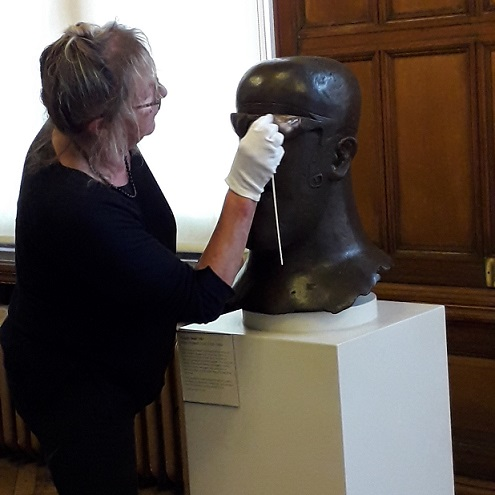 Conservator Sally Bowling at work