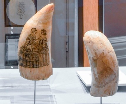 Engraved whalebone depicting two ladies with a book. Engraved walrus tusk depicting a dual, the female with her arms aloft.