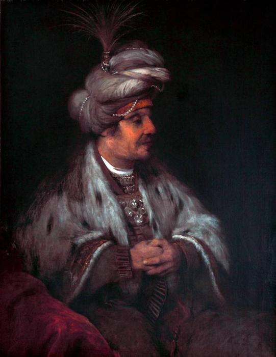 A man dressed in an outfit that resembles those of senior leaders of the Ottoman Empire