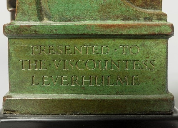 Lettering in plinth of sculpture: PRESENTED TO THE VISCOUNTESS LEVERHULM