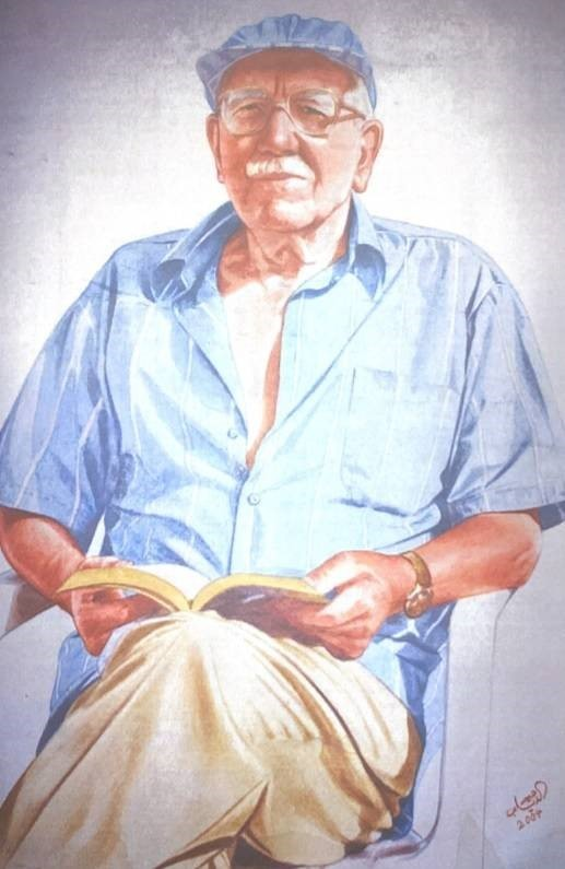 Colourful portrait painting of William Dickinson Davies sat cross legged in a chair with a book in his hands. He looks a little past the viewer, he wears a peaked sun hat, a pale blue shirt and chino style trousers. He is wearing glasses and a wrist watch. He looks relaxed and calm.