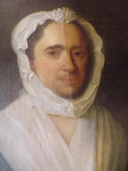 'Lady Holding a Jasmine Flower' portrait shown half professionally cleaned and conserved.