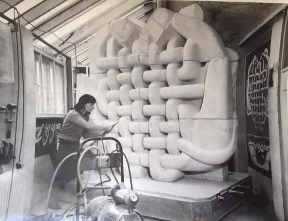 Mitzi working on the architectural sculpture Man Made Fibres c.1956 for the University of Leeds (©Estate of the Artist)