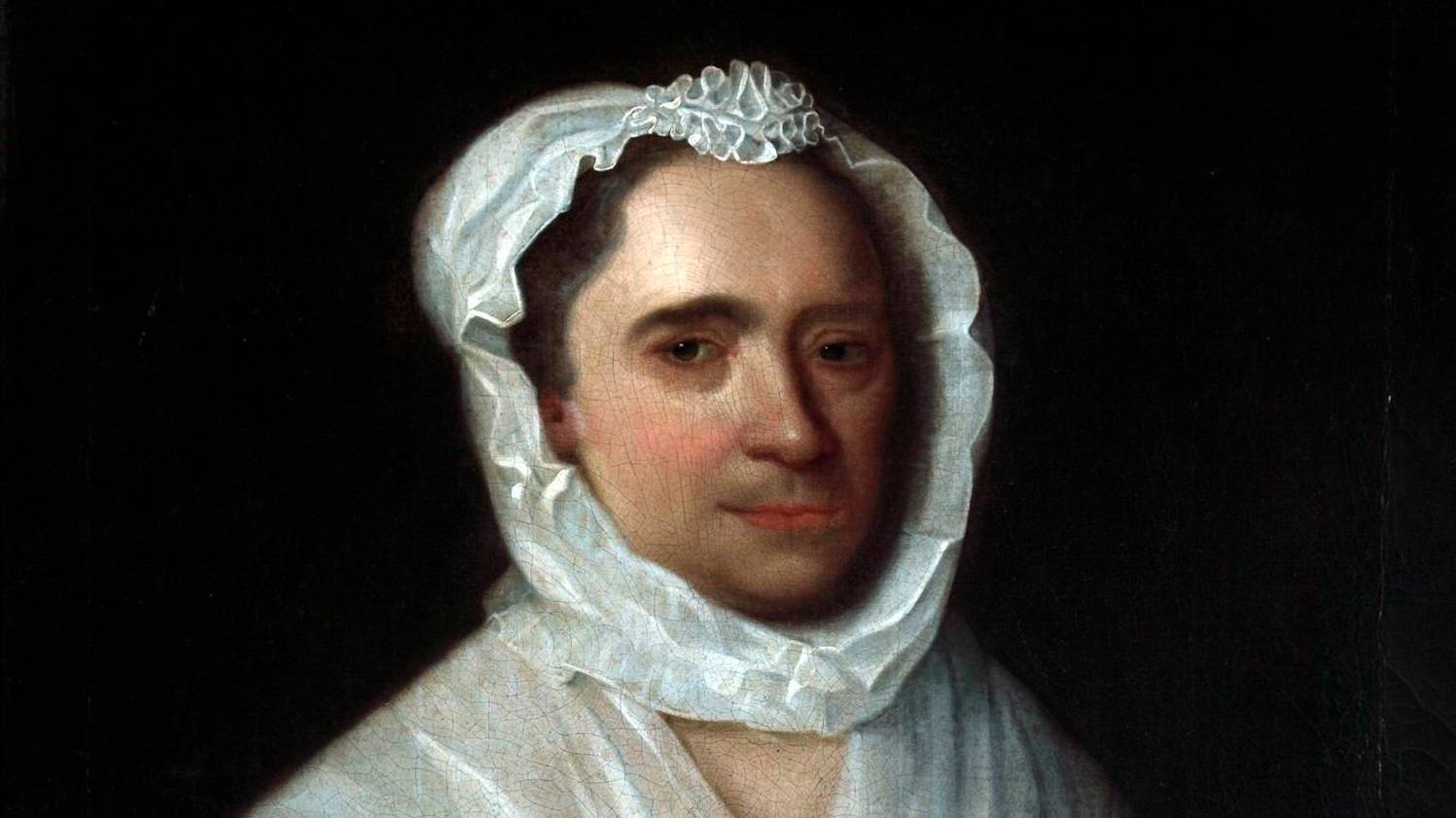 Detail of a portrait of a woman wearing a blue silk dress holding a jasmine flower with a white bonnet and collar. She holds a jasmine flower in her right hand. The lower half of her face has a five o'clock shadow.