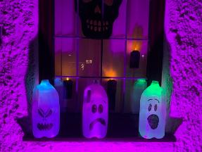 Create glowing ghosts from recycled milk bottles
