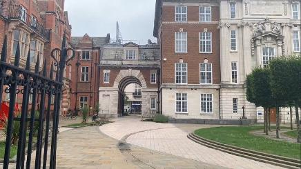 Walk towards the Ashton building archway, pass underneath, turn right