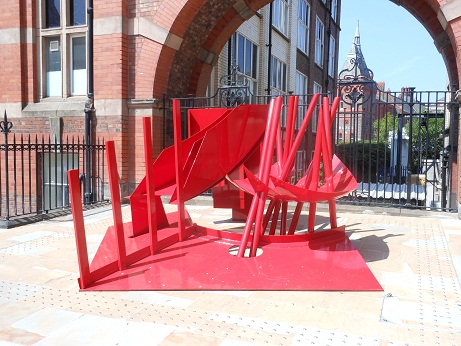 Red Between by Philip King is located in the quadrangle to the left of the Ashton Building.